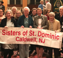 SISTERS AND ASSOCIATES HEAR NUNS ON THE BUS SPEAKERS