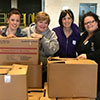 ASSOCIATES VOLUNTEER AT FOOD BANK